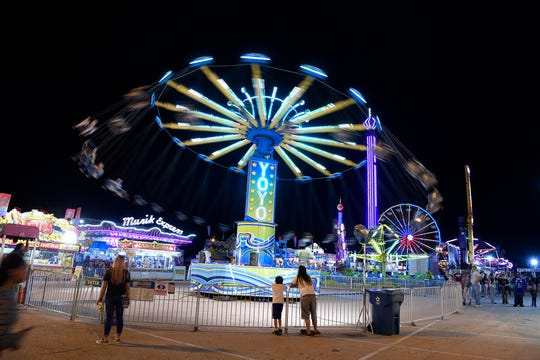 Fair goers take to the rides on a rain-free evening at the York Fair, Thursday, Sept. 13, 2018.  John A. Pavoncello photo