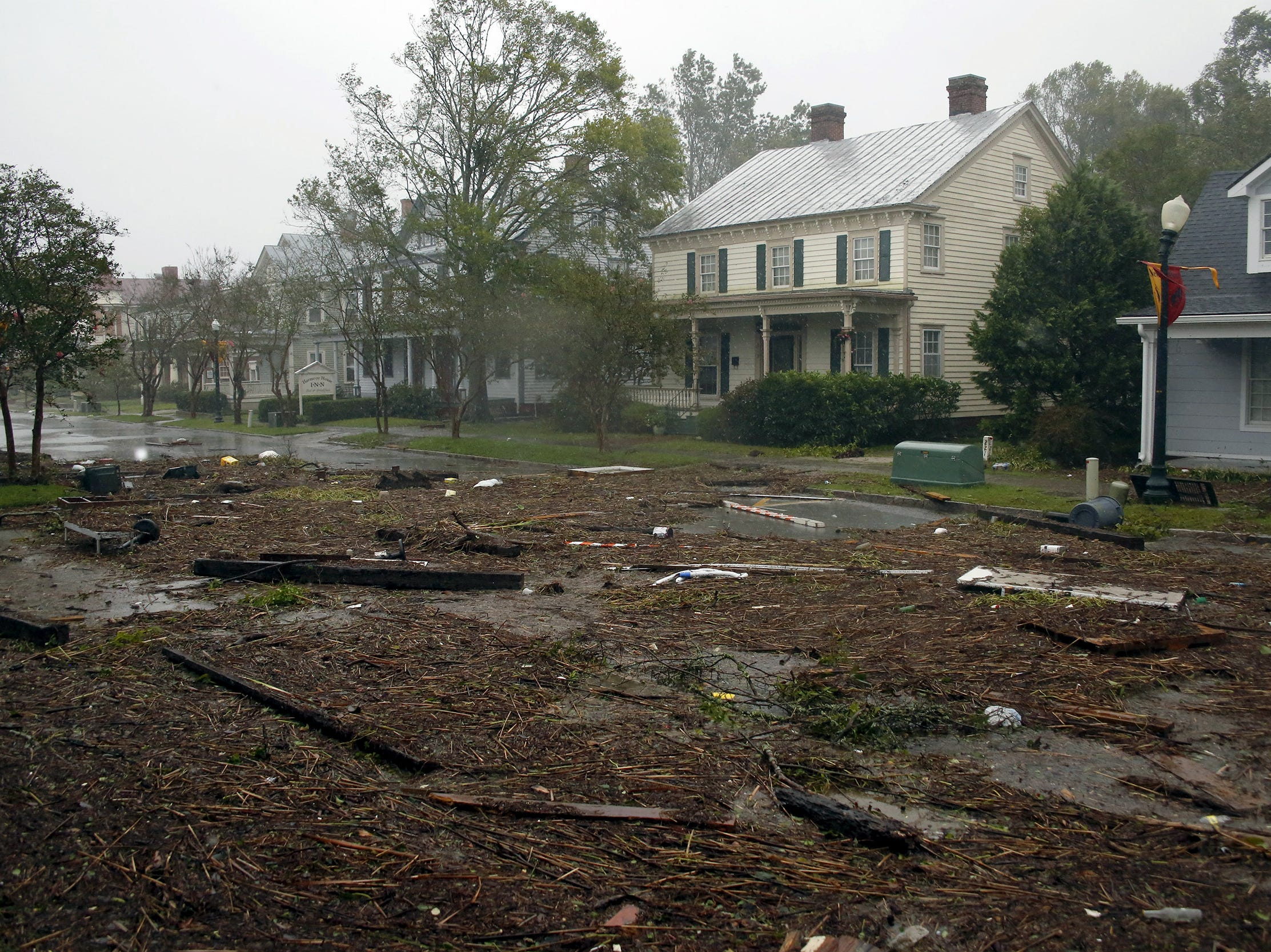 Debris from Hurricane Florence covers a street in downtown New Bern, N.C., on Friday, Sept. 14, 2018. (AP Photo/Chris Seward)