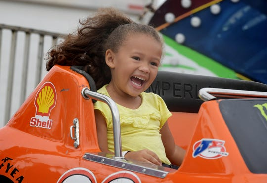 Arya Watkins, 4, of York Township, reacts on the Speedway ride at the York Fair children's midway Friday, Sept. 14, 2018. The fair continues through Sunday, Sept. 16. Bill Kalina photo