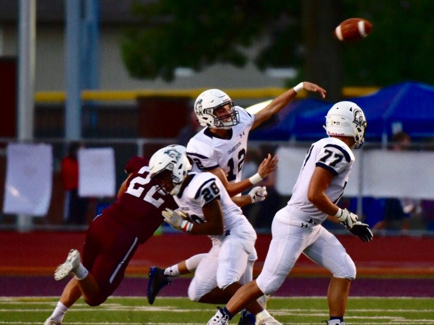 Chambersburg quarterback Brady Stumbaugh throws a pass before Altoona's pass rush gets to him.