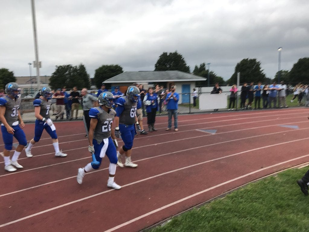 Cedar Crest players get ready to take the field before Friday's game against McCaskey.