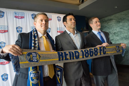 Ian Russell, center, is introduced as the Reno 1868 FC soccer coach in 2016.  Andy Smith, team GM is left, and Reno Aces president Eric Edelstein is right.