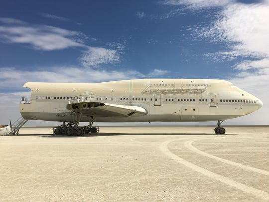 Dustin Mosher flew his small airplane over the Black Rock Desert and spotted the Big Imagination Camp's 747 from Burning Man approximately 14 miles north of its location at Black Rock City. He landed and explored the area, shooting photos of the airplane in its new parking spot.