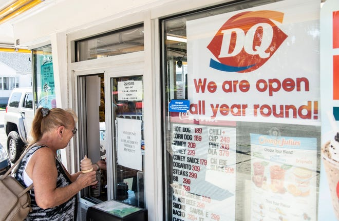 A woman holds an ice cream cone at Dairy Queen on Richmond's south side, 1018 S. Ninth St., on Friday, Sept. 14, 2018.