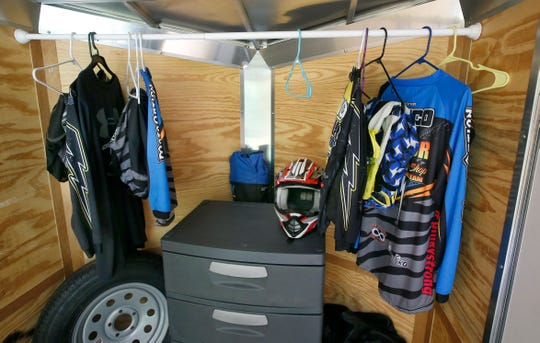 Racing clothes of AJ Amico, 10, and his sister Nina Amico, 8, who are highly ranked BMX riders who have a track at their house in Webster. Their younger brother is Dominic Amico, 1, and their father is Jeff Amico.