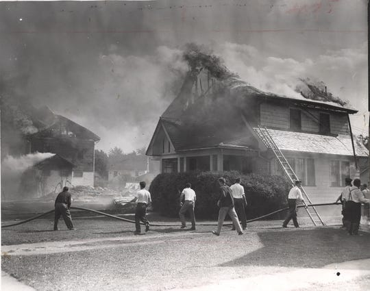 Three homes on Antlers Drive in Brighton, two burning and the middle one completely destroyed, after gas explosions rocked the quiet residential neighborhood near the Twelve Corners. (Staff photo 9/21/1951)