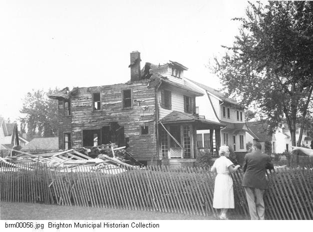 People look at a house on Fair Oaks Avenue damaged by a series of gas explosions on Sept. 21, 1951.