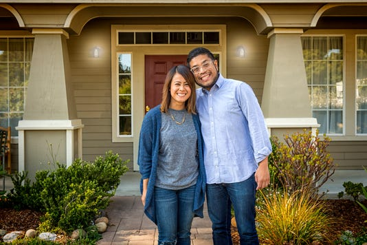 Young Asian American Couple At Home