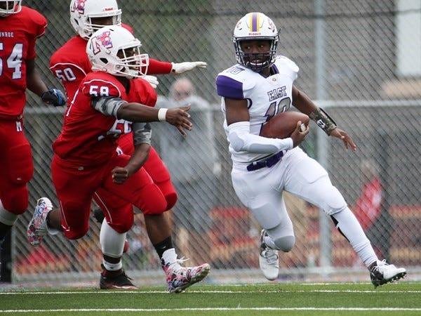 East quarterback Anthony Gilbert avoids the Monroe defense.
