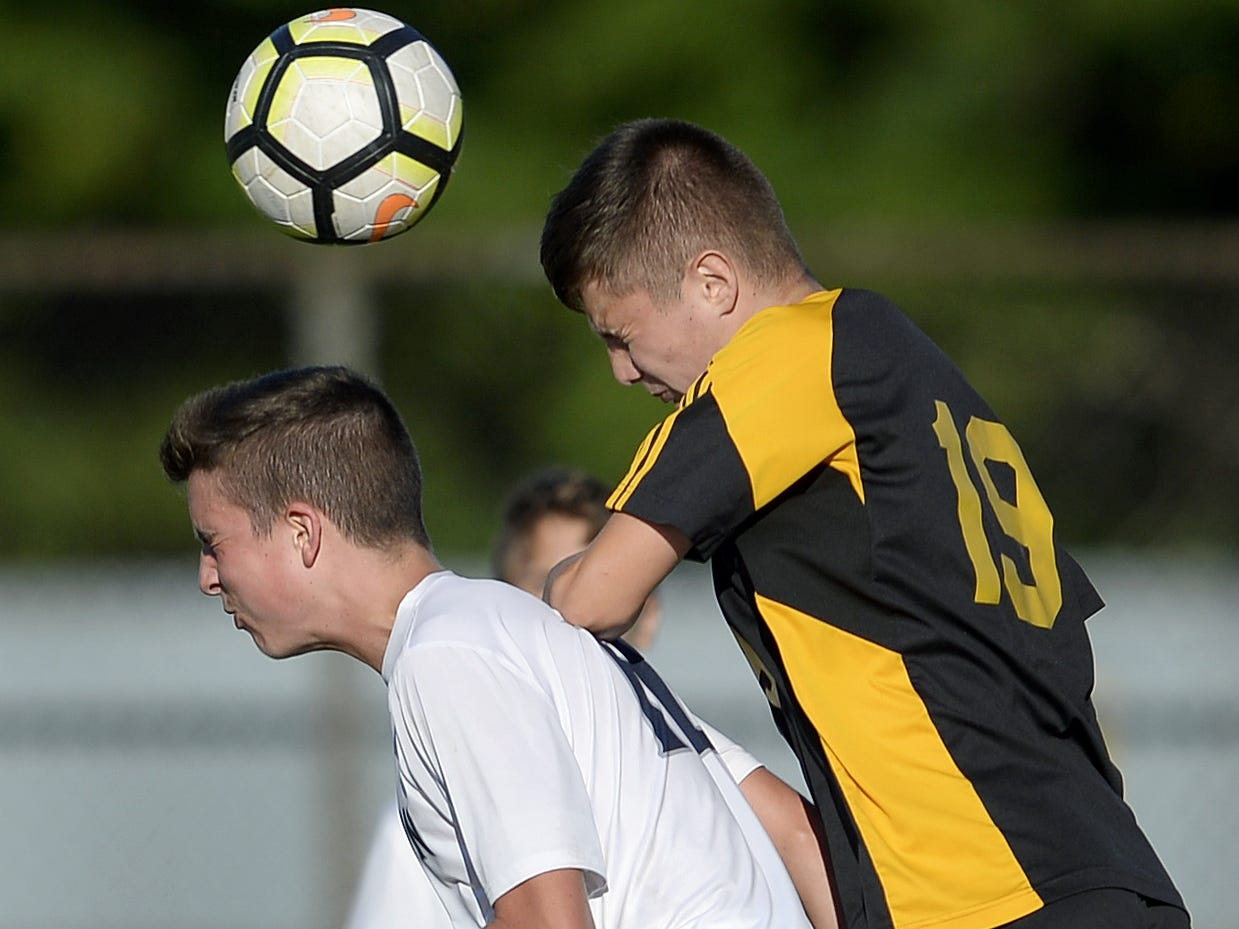 Greece Athena's Gavin Rice, right, challenges for a header against Brighton's Connor McQuillan during a regular season game played at Greece Athena High School, Thursday, Sept. 13, 2018. Greece Athena beat Brighton 1-0.