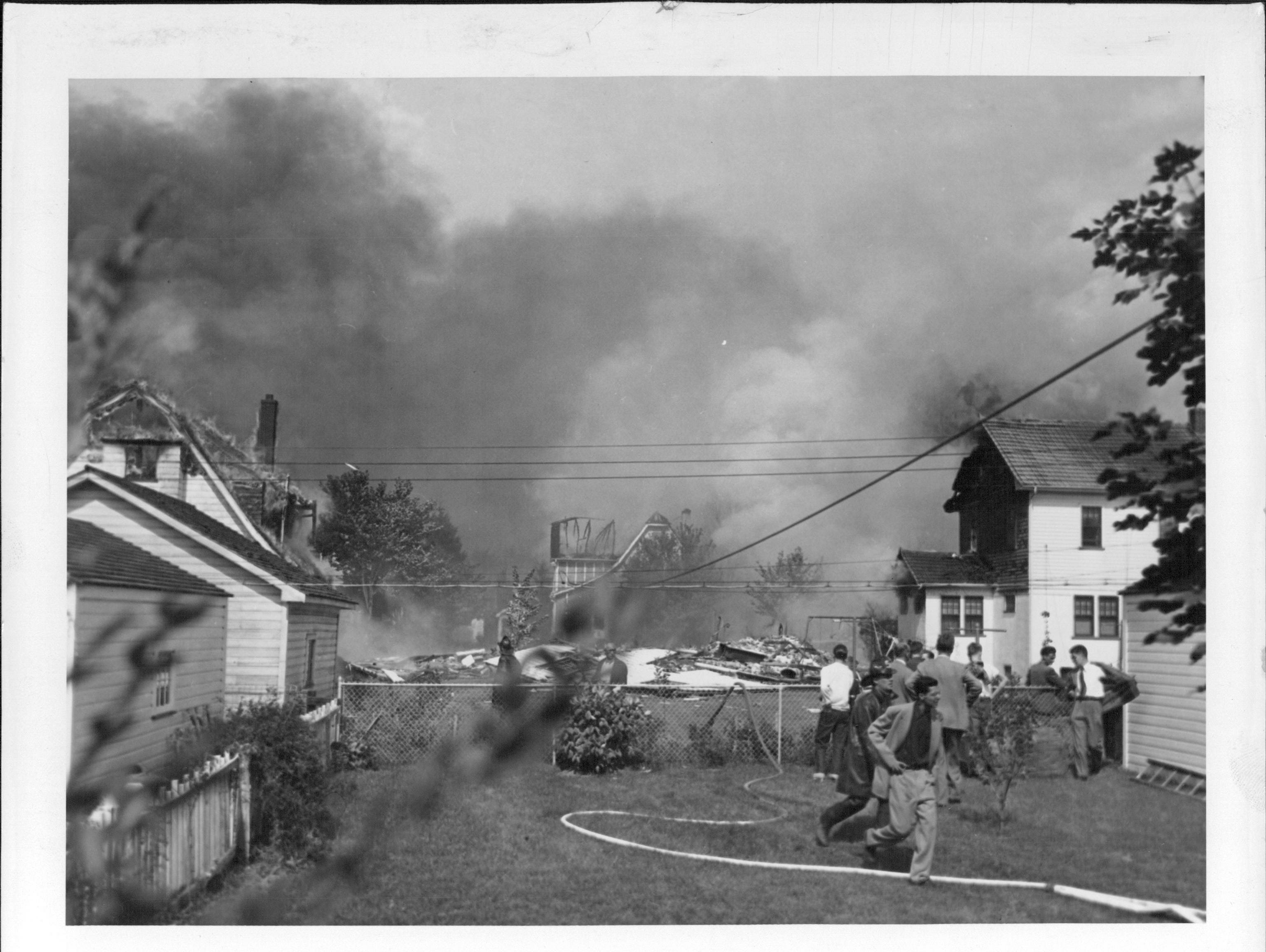 Smoke fills the air above a Brighton neighborhood.  (Staff photo, 9/21/1951)