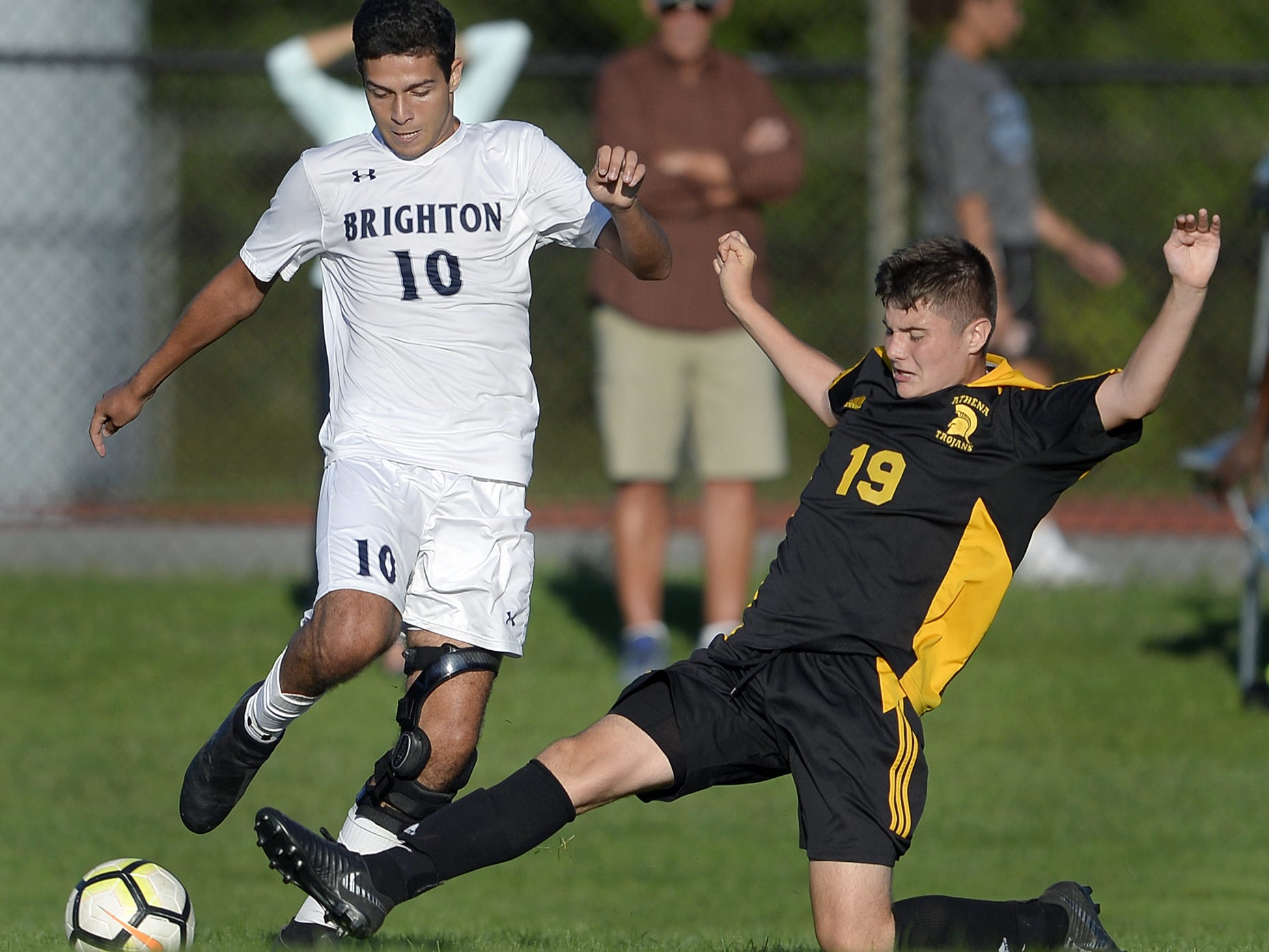 Brighton's Caio De Medeiros, left, is defended by Greece Athena's Gavin Rice during a regular season game played at Greece Athena High School, Thursday, Sept. 13, 2018. Greece Athena beat Brighton 1-0.