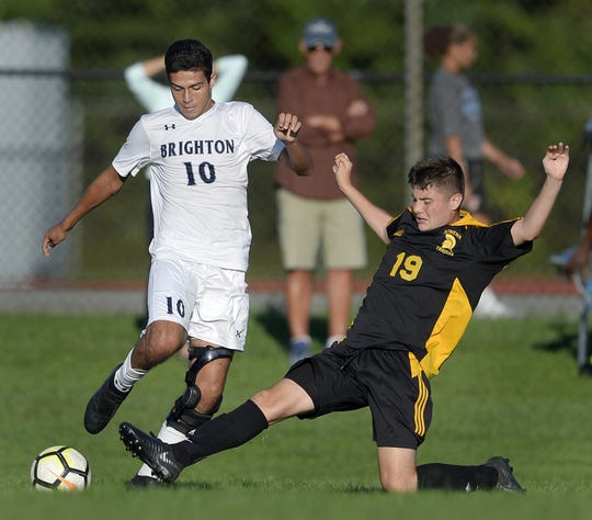 Brighton's Caio De Medeiros, left, is defended by Greece Athena's Gavin Rice during a regular season game played at Greece Athena High School, Thursday, Sept. 13, 2018. Greece Athena beat Brighton 1-0. Brighton enters sectional play having won nine of its last 10 games.