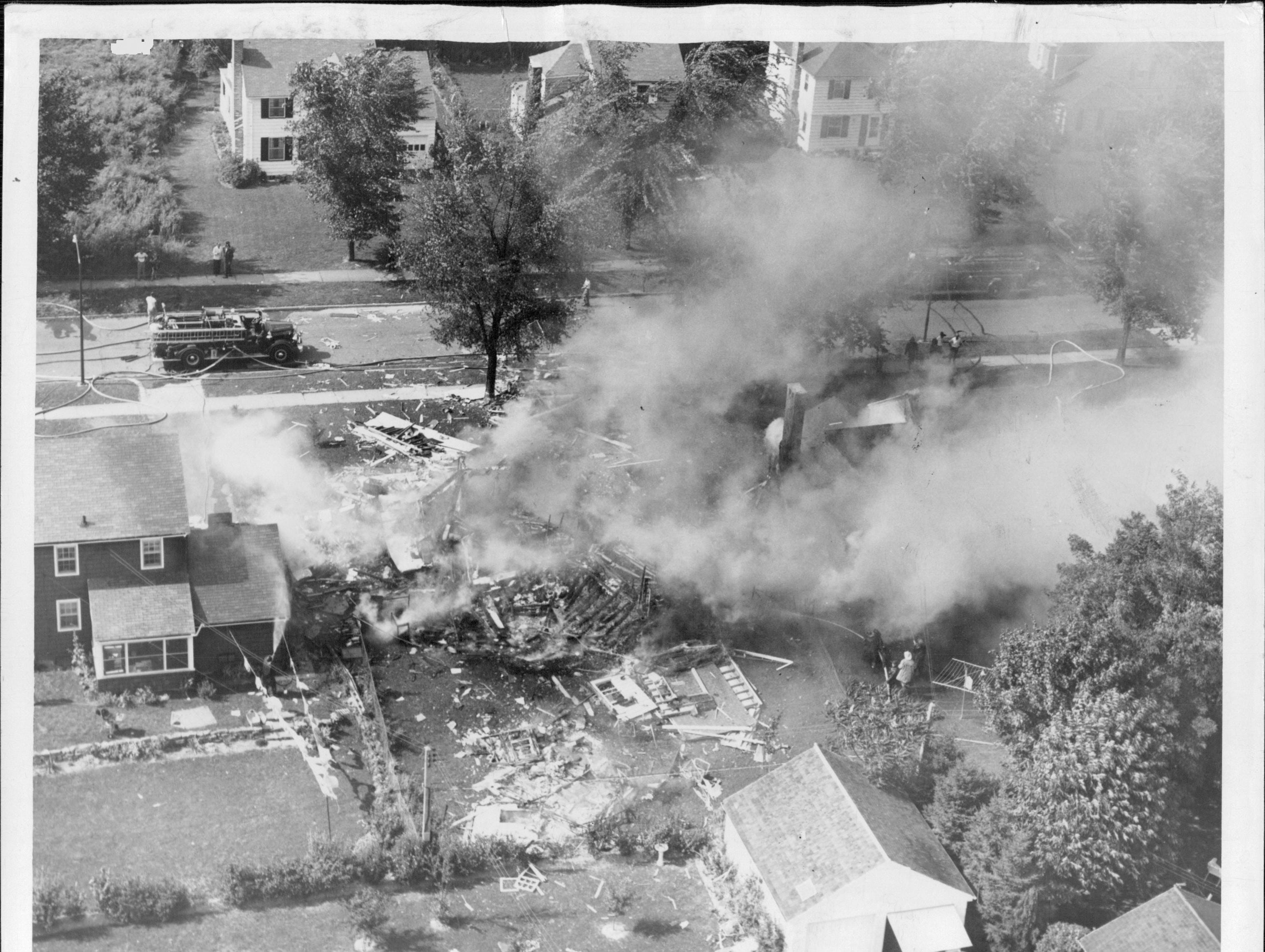 A Brighton home reduced to rubble.  (Staff photo, 9/21/1951)