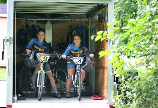 AJ Amico, 10, and his sister Nina Amico, 8, are highly ranked BMX riders who have a track at their house in Webster. Seen here about to exit the trailer to go for a practice ride with their friends.