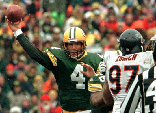 Green Bay Packers quarterback Brett Favre, shown throwing a pass against the Bears' Chris Zorich on  Nov. 12, 1995, did not start a single game as a rookie.