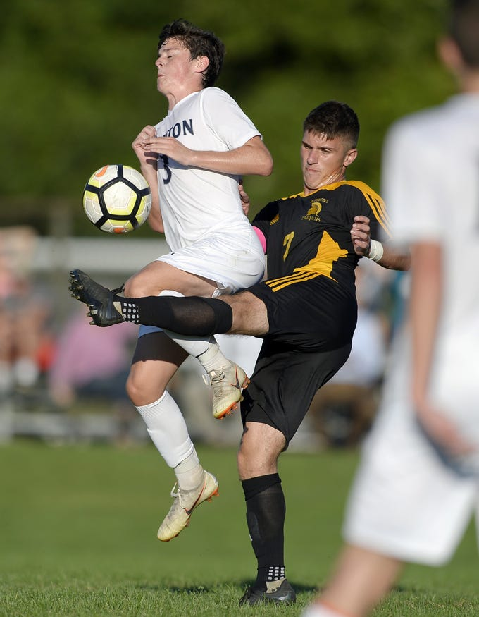 Greece Athena's CJ Takatch, right, clears the ball away from Brighton's Mat Ochs during a regular season game played at Greece Athena High School, Thursday, Sept. 13, 2018. Greece Athena beat Brighton 1-0.
