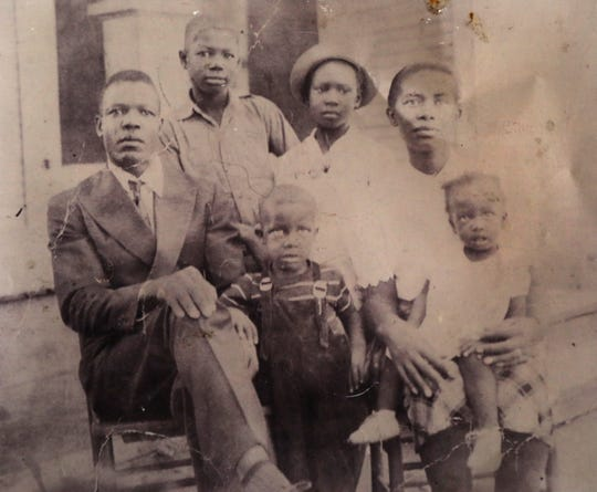 Luther Younger and sister Marzella Rambow (bottom center and left) in a family photo. Younger claims he is 10 years old in the photo. Rambow was born in 1943 and states that Younger was born in 1941, just as public records suggest.