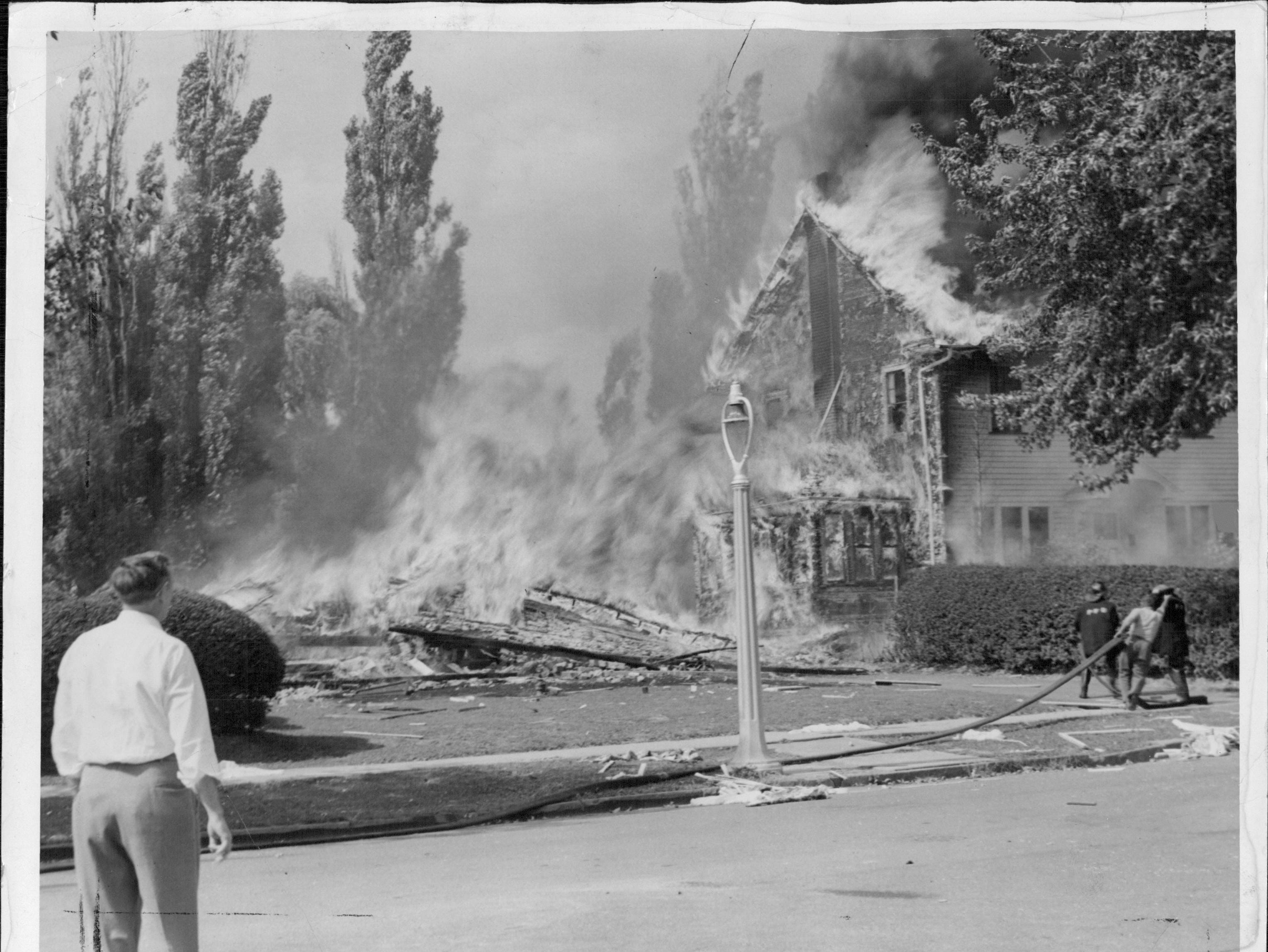 One Sylvan Road home has been destroyed and another is burning furiously. (Staff photo, 9/21/1951)