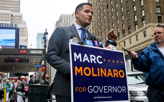 "New York Republican gubernatorial candidate Marc Molinaro start his campaign against incumbent Gov. Andrew Cuomo, announcing his statewide ""Cuomo Corruption Tour,"" Friday Sept. 14, 2018, in New York City."