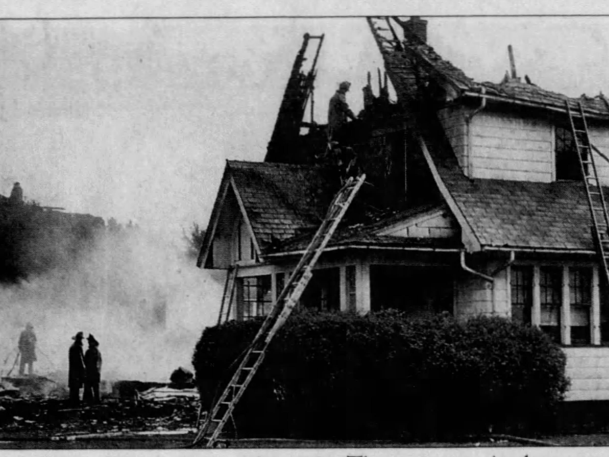 Antlers Drive explosion leveled one home, center, and set two others afire. (Staff photo, 9/21/1951)