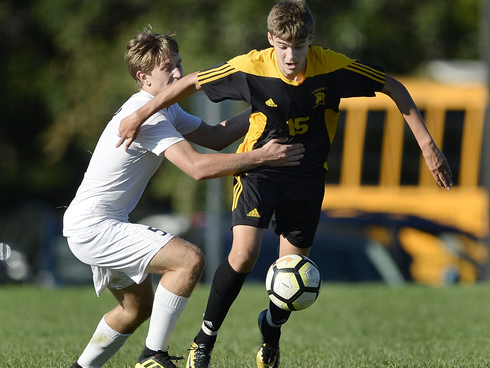 Greece Athena's Ryan Fitzgerald, right, is defended by Brighton's Theo Viggiani-Cole during a regular season game played at Greece Athena High School, Thursday, Sept. 13, 2018. Greece Athena beat Brighton 1-0.