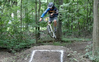 AJ Amico, 10, and his sister Nina Amico, 8, are highly ranked BMX riders who have a track at their house in Webster.