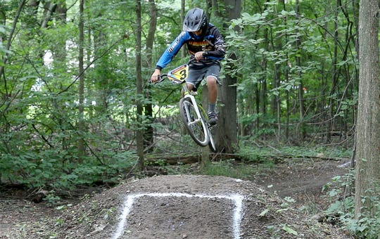 AJ Amico, 10, is a highly ranked BMX rider who has a track at his house in Webster. His sister Nina, 8, is also a BMX rider.