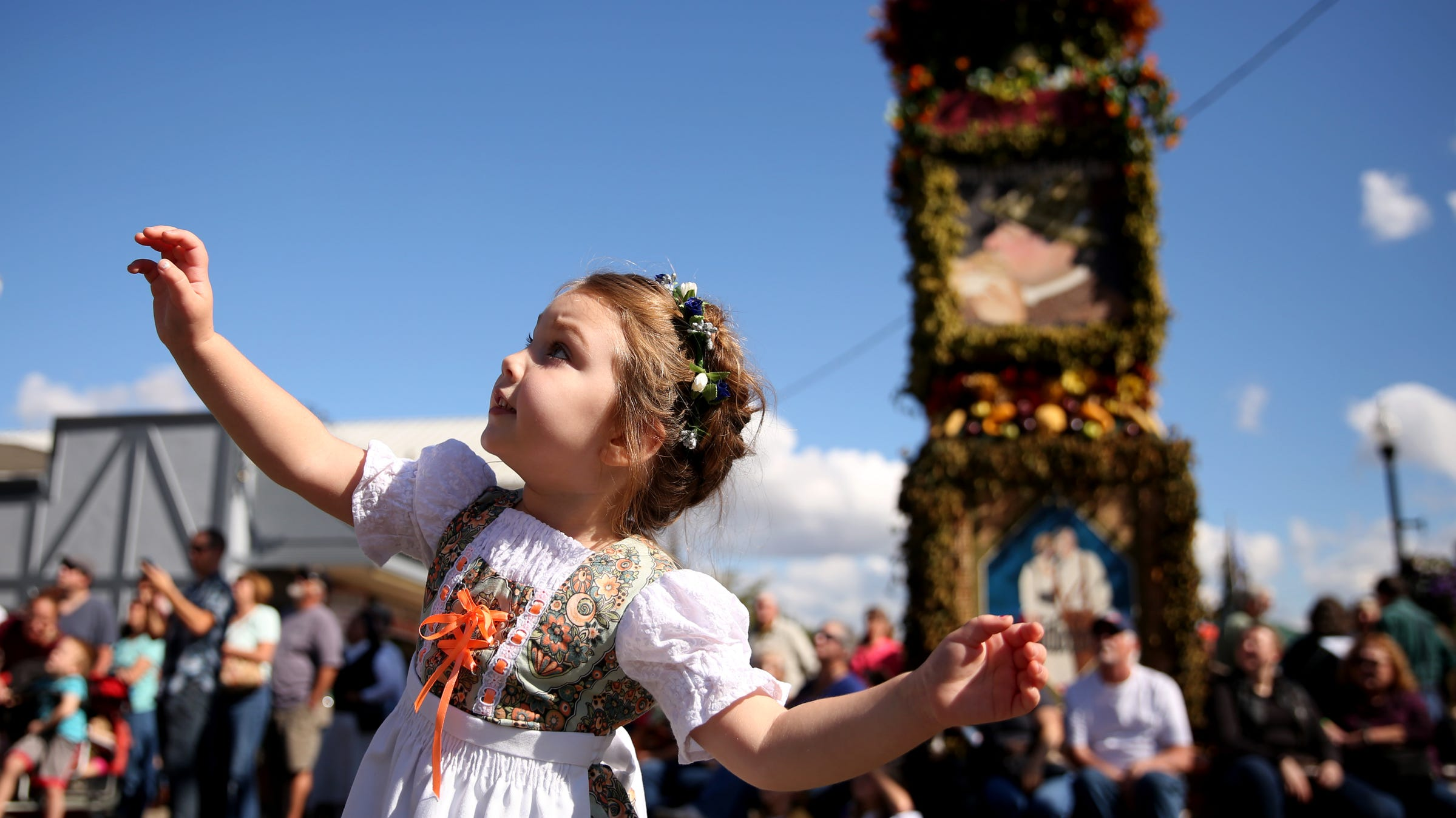 Macy Yanez, 3, of Salem, dances and watches the Glockenspiel play during Oktoberfest in Mt. Angel on Friday, Sep. 14, 2018. Oktoberfest continues Saturday and Sunday.