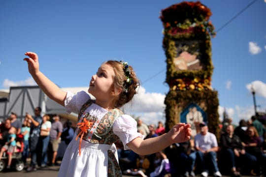 Macy Yanez, 3, of Salem, dances and watches the Glockenspiel play during Oktoberfest in Mt. Angel on Sep. 14, 2018.