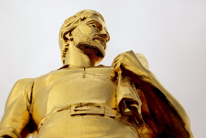 The Oregon Pioneer, also known as the Gold Man, on top of the Oregon State Capitol in Salem on Thursday, Sep. 13, 2018.