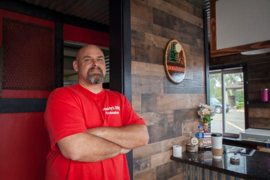 Squatchy's BBQ owner, Jason Lorraine stands at the counter of his new brick and mortar restaurant location in Stayton, Oregon Thursday September 13, 2018. Just a few months since his original Squatchy's BBQ trailer burned, he is opening the new location thanks to the generosity of those who contributed through a Go Fund Me campaign set-up for Jason and his wife Julie following the fire.