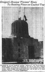 The Oregon Pioneer dangles from the rigging of a crane above the dome of the newly constructed Captiol in a photo published Sept. 18, 1938 in The Oregon Statesman.