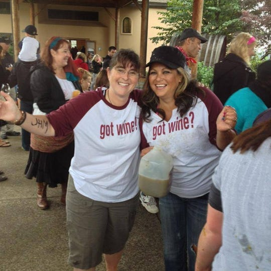Kristi Reed, 48 of Dallas, and Soraida Cross, 43 of Keizer, at the Willamette Valley Vineyards Oregon Grape Stomp Championship & Harvest Celebration in 2011. This photo was taken when they won.