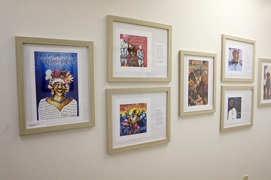 Art work and poetry line the hallways inside the Open Arms Rape Crisis Center+ LGBT+ Services new office building Thursday, Sept. 13, 2018.