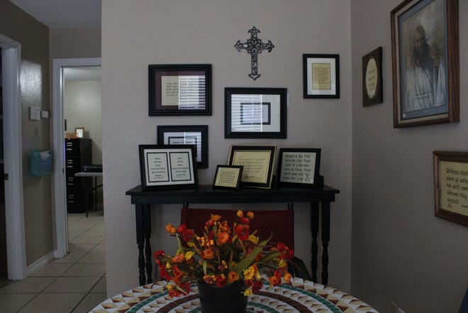 Interior of The Word Script, 2808 Sherwood Way, as well as some of the frames being sold.