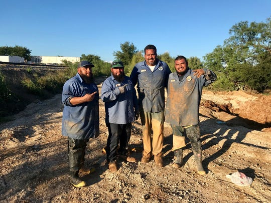 Some of the water distribution crew taking a break from repairing the water main break that occurred Tuesday, Sept. 11.