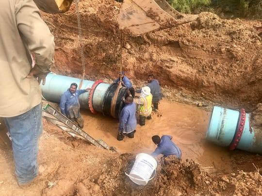 Water distribution crew working to repair the water main break that occurred Tuesday, Sep. 11, near South Jackson Street.