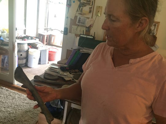 Ecotour guide Meriwether Payne of Locustville, Virginia holds a bone of unknown origin, which she found along with a message in a bottle on Cedar Island, Virginia on Tuesday, Sept. 11, 2018.