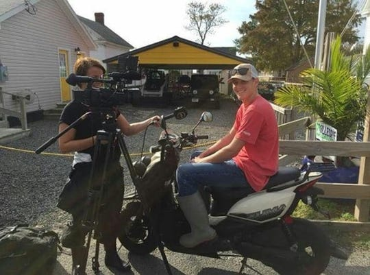 Tangier native Cameron Evans is interviewed by a film crew from Finland.