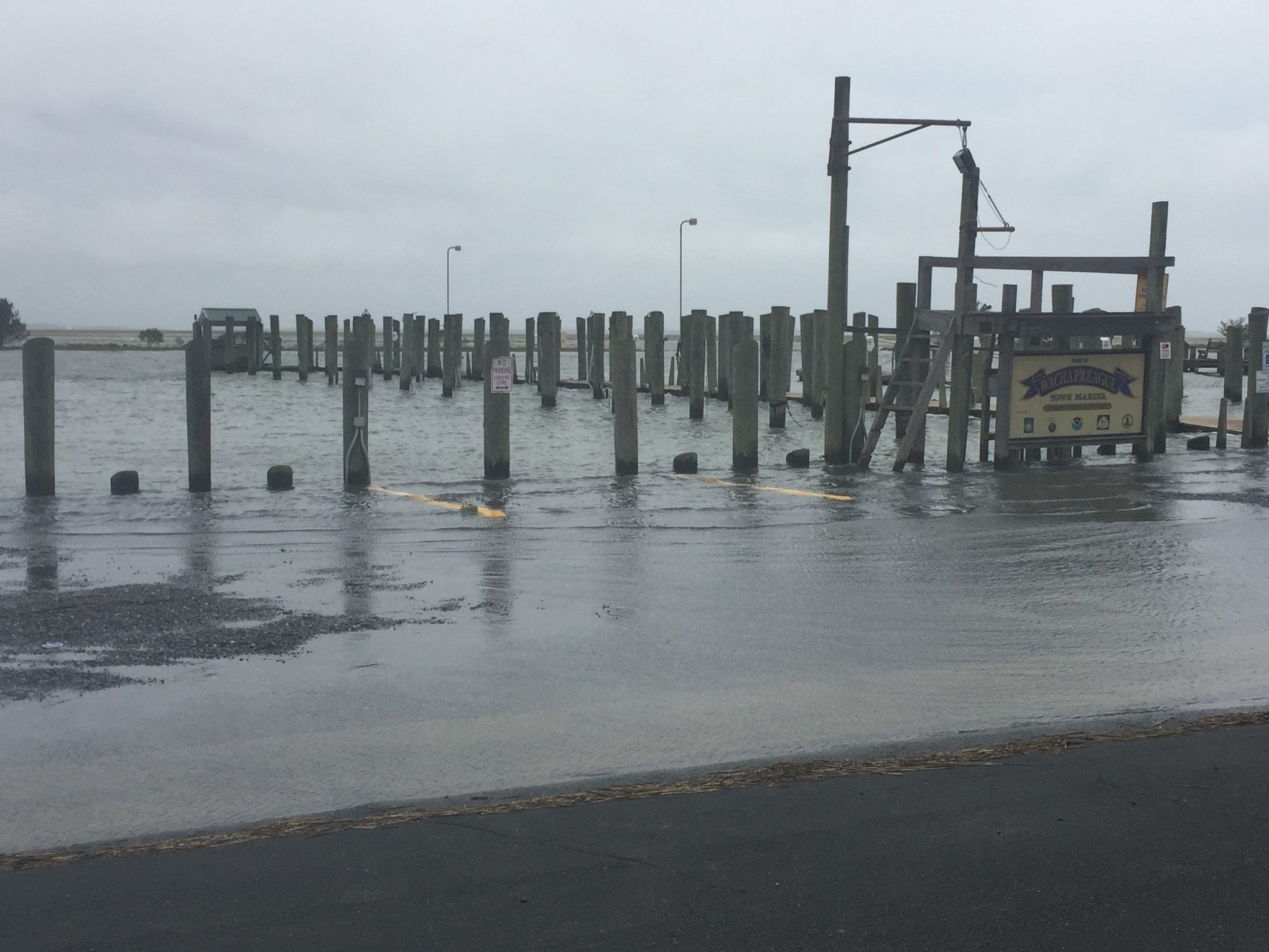 The marina at Wachapreague, Virginia experiences minor coastal flooding during high tide Friday, Sept. 14, 2018 as result of Hurricane Florence.