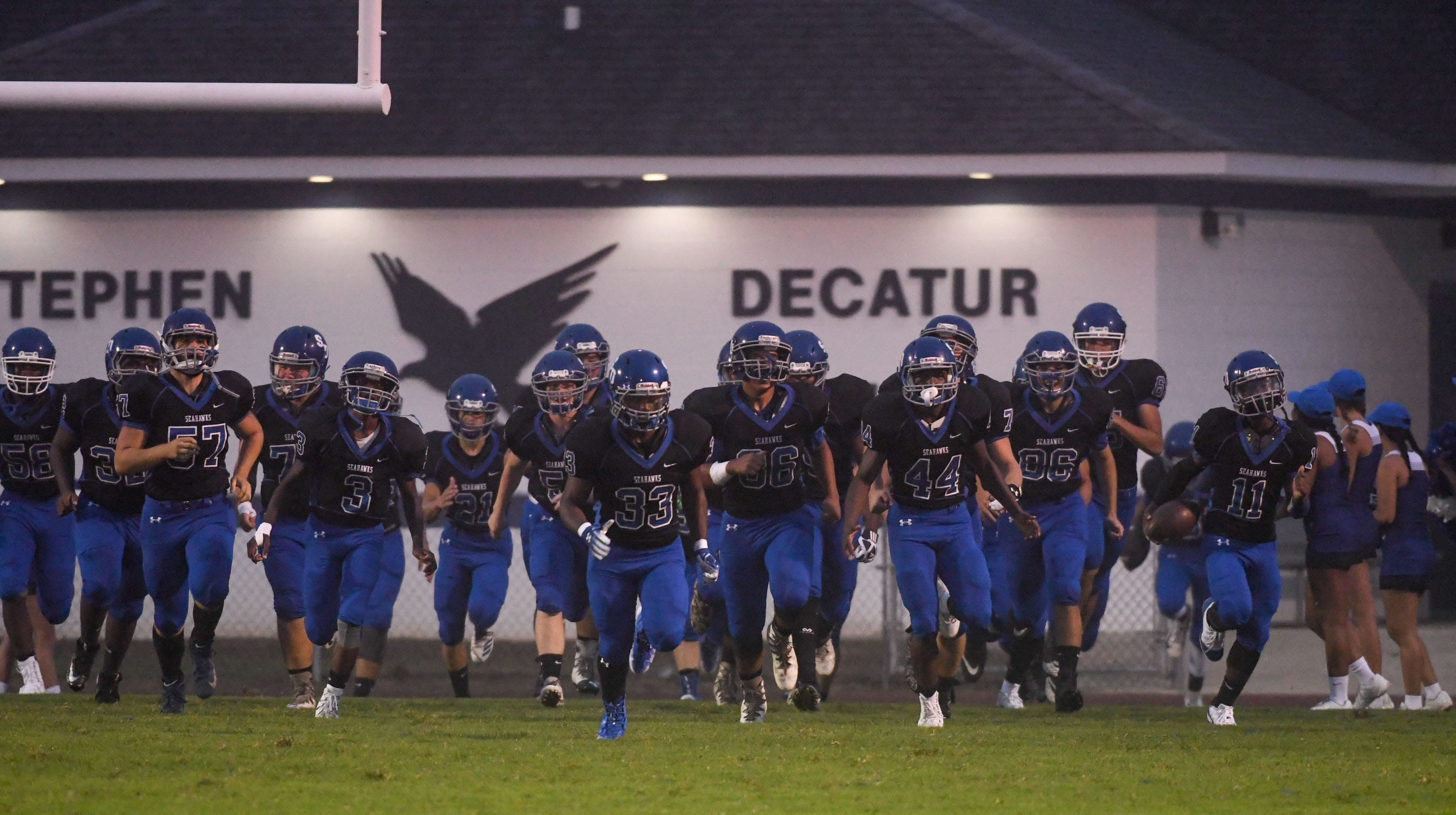 Stephen Decatur runs onto the field before the game against Washington on Thursday, Sept. 14, 2018. In Berlin, Md.