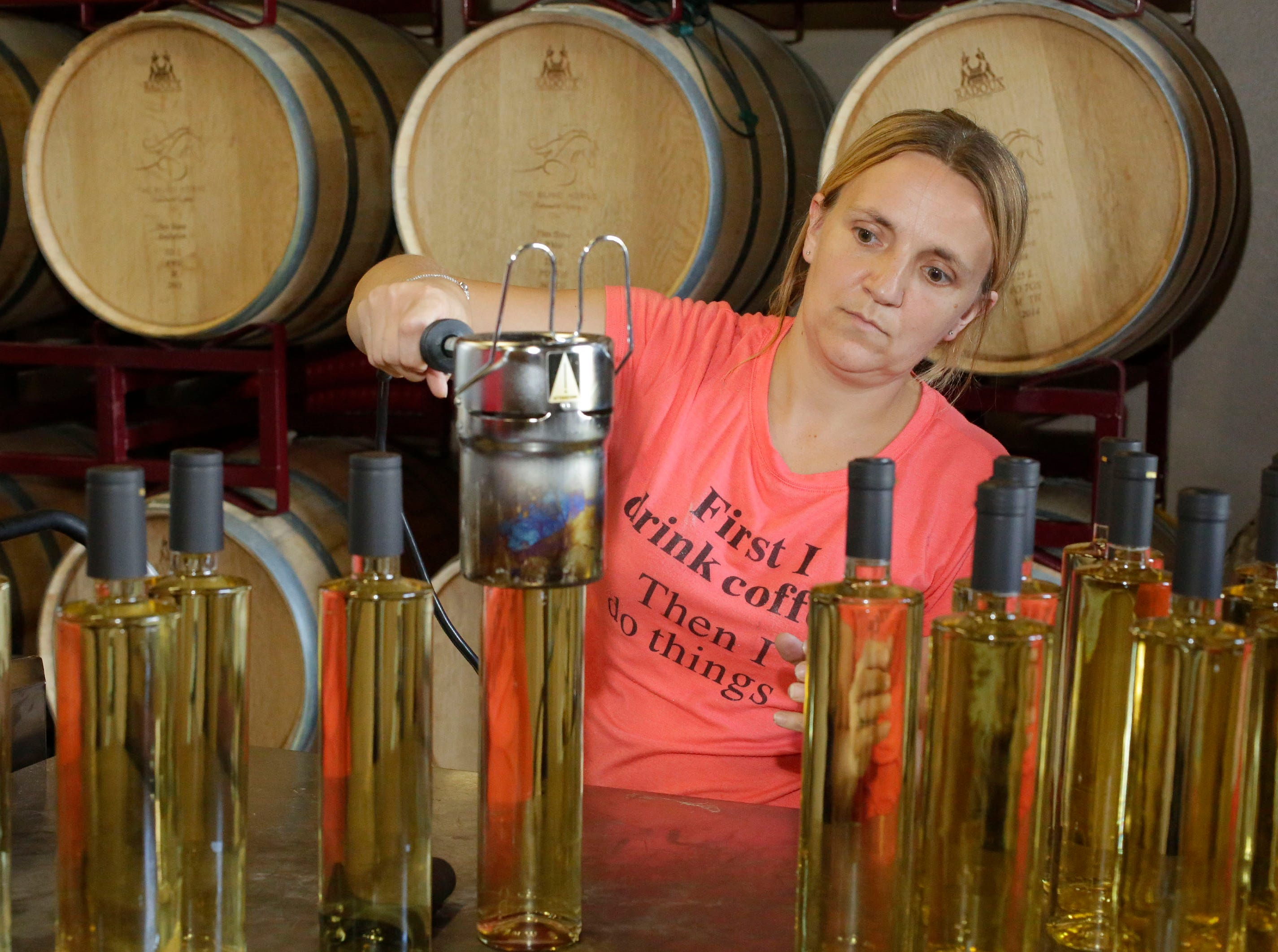 Laura Champeau-Byrd, of South Milwaukee, Wis., works on bottling Chardonnay reserve wine at The Blind Horse restaurant and winery, Thursday, September 13, 2018, in Kohler, Wis.