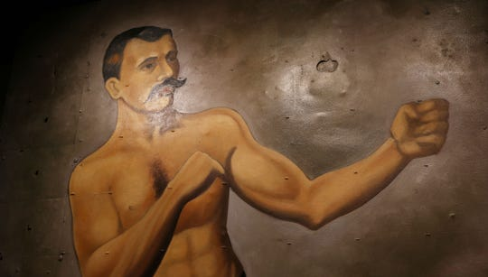 Artwork of a bare-knuckled brawler in The Granary at the Blind Horse Restaurant & Winery in Kohler.