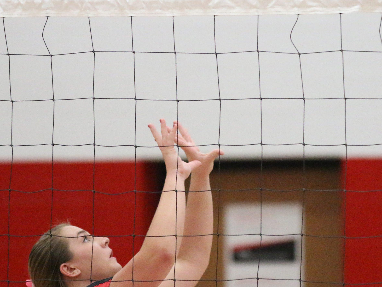 Oostburg's Lauren Arndt (14) sets the ball against Sheboygan Christian, Thursday, September 13, 2018, in Oostburg, Wis.