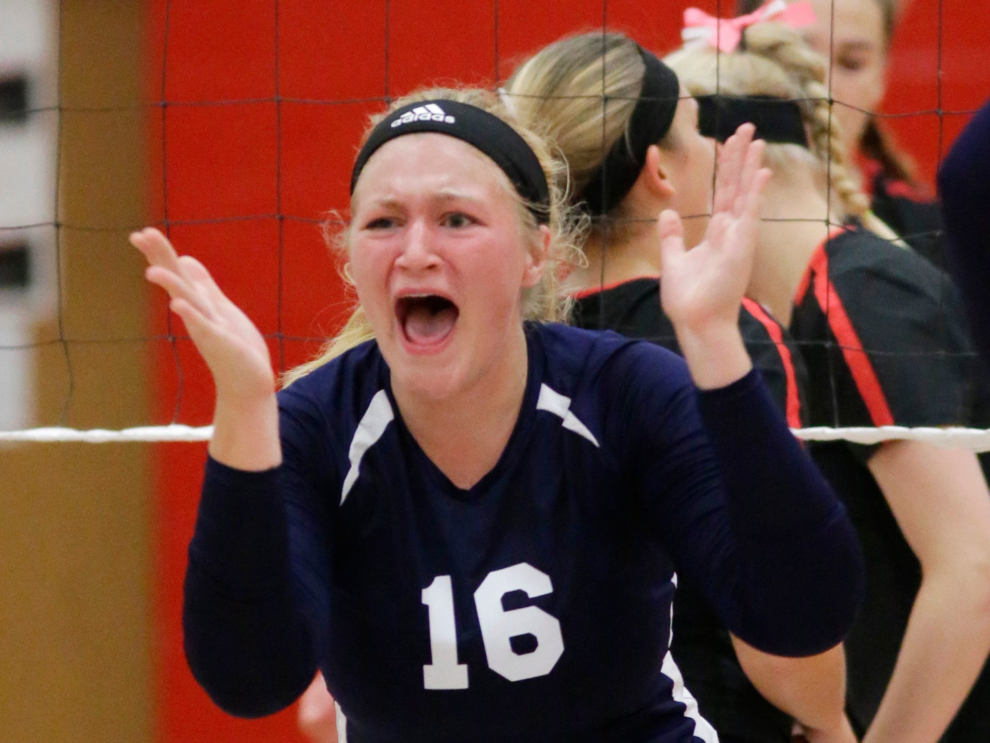 Sheboygan Christian reacts to a point against Oostburg, Thursday, September 13, 2018, in Oostburg, Wis.