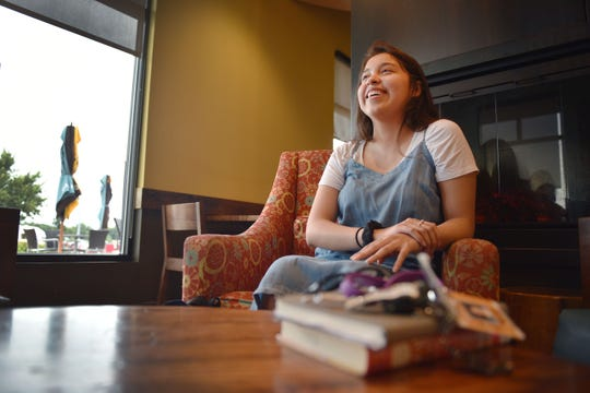 Washington high school student Merari Rivera talks about how her large family has influenced her work ethic Thursday, Sept. 13, at Caribou Coffee in Sioux Falls.