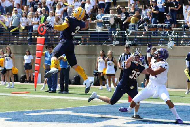 Michael Kloza makes a leaping, one-handed interception last week against MSU-Mankato