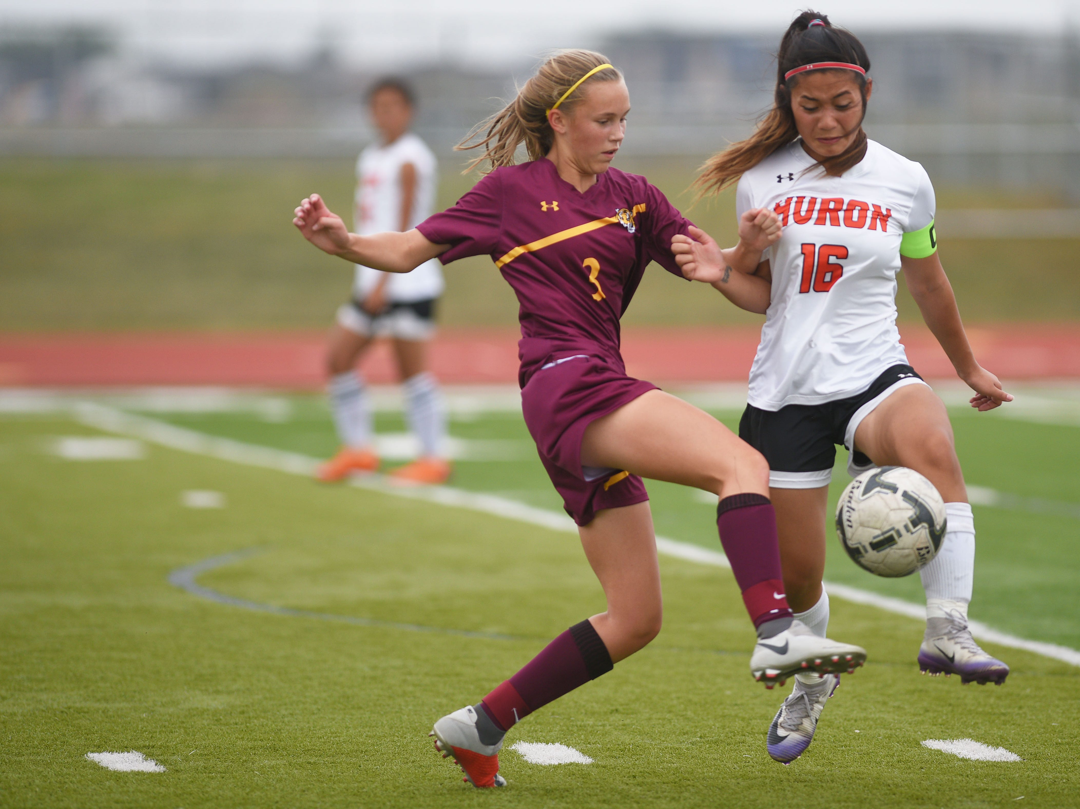 Harrisburg's Sydney Hage goes against Huron's Wah Ku Htoo during the game Thursday, Sept. 13, at Harrisburg.