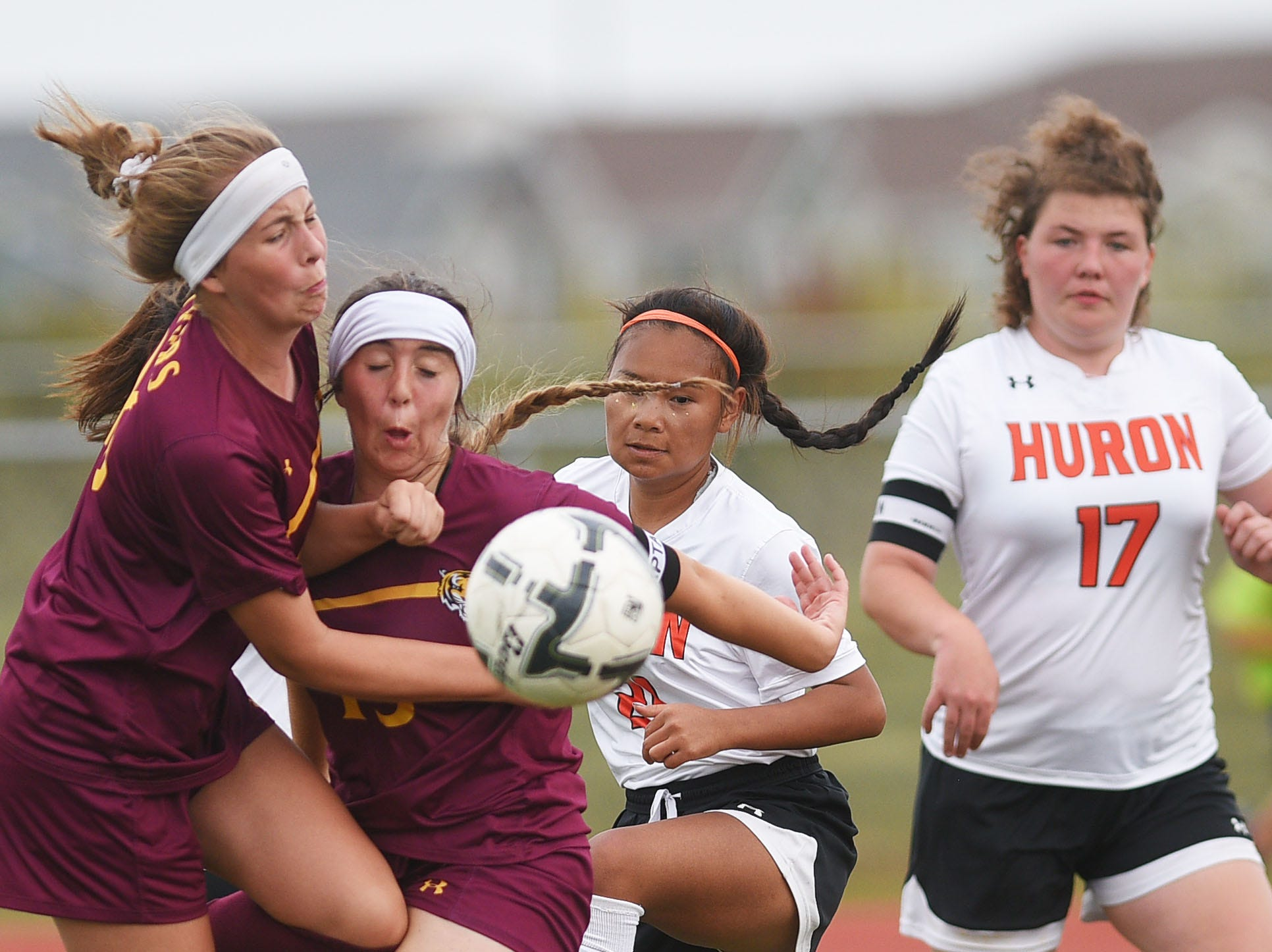 Harrisburg's Paige Wood, from left, Lily Petersen, Huron's Paw Tar Hsu and Shelbey Hershman try to gain control off the ball Thursday, Sept. 13, at Harrisburg.